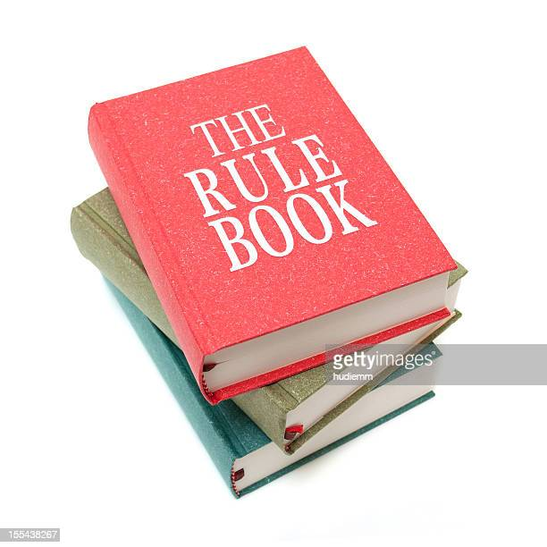 the rule books isolated on white background - employment law stock photos and pictures