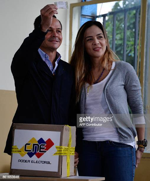 The ruling party's governor of the Venezuelan state of Tachira Jose Vielma Mora votes at a polling station in San Cristobal Tachira during regional...
