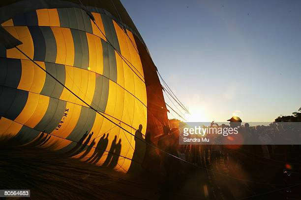 The run rises as spectators watch the hot air balloons prepare to fly out of Innes Common during the Balloons Over Waikato Festival on April 9 2008...