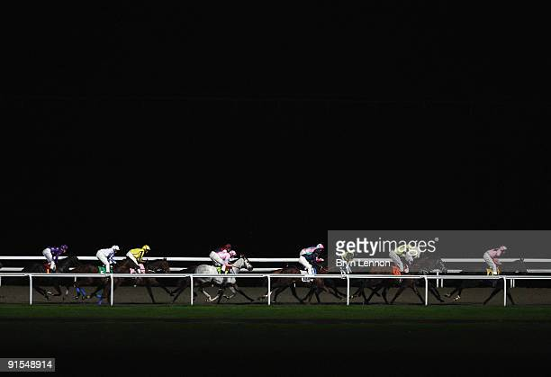 The runners and riders make their way down the back straight in The digibet Handciap Stakes at Kempton Park Racecourse on October 7 2009 in Staines...