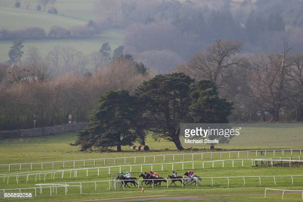 The runners and riders turn into the finishing straight during the Recticel Handicap Hurdle race at Chepstow Racecourse on March 23 2017 in Chepstow...