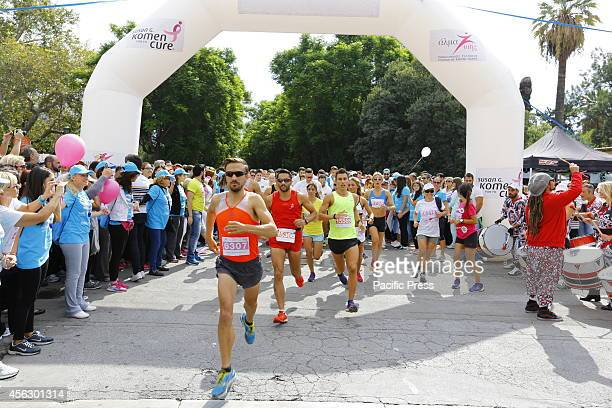 The runners cross the starting line of the Race for the Cure More than 15000 runners took part in the Greek Race for the Cure to race money for a...