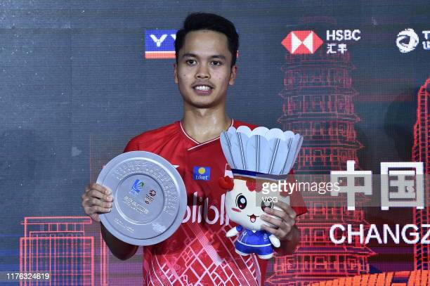 The runner-up Anthony Sinisuka Ginting of Indonesia poses with his trophy on the podium after the Men's Singles final match on day six of 2019 China...