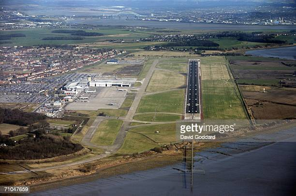 The runway of Liverpool's John Lennon airport heads out towards the River Mersey in this aerial photo taken on July 10 2005 above Liverpool England