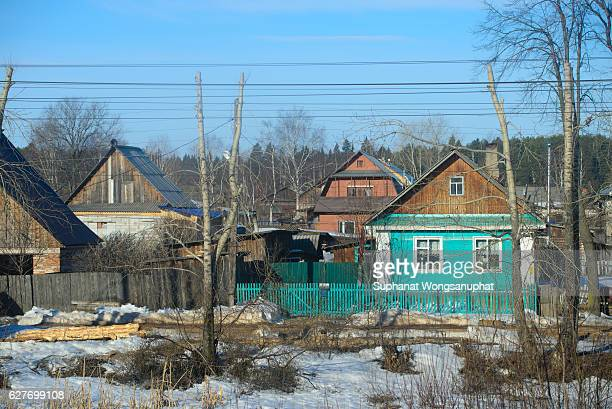 The rural house covered with snow in the winter, Trans Siberia railway, Russia