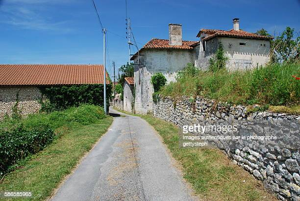 The rural road along the stone wall