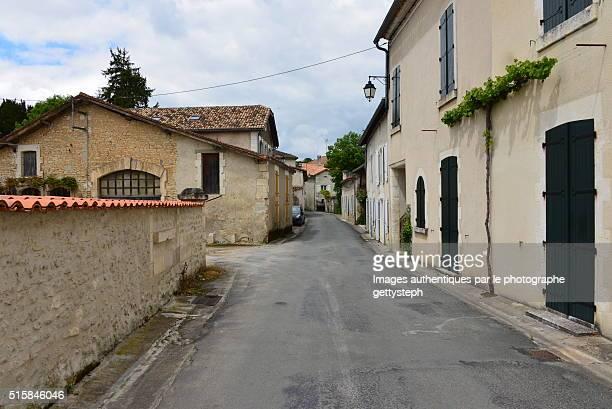 The rural street between old walls