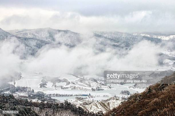 The rural town which was covered by white snow under the mountain