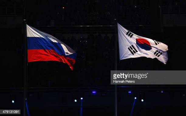 The Russia and South Korea flags fly during the Sochi 2014 Paralympic Winter Games Closing Ceremony at Fisht Olympic Stadium on March 16 2014 in...