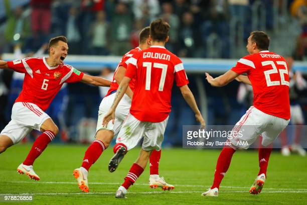 The Russia players celebrate after Ahmed Fathi of Egypt scored an own goal to make it 10 during the 2018 FIFA World Cup Russia group A match between...