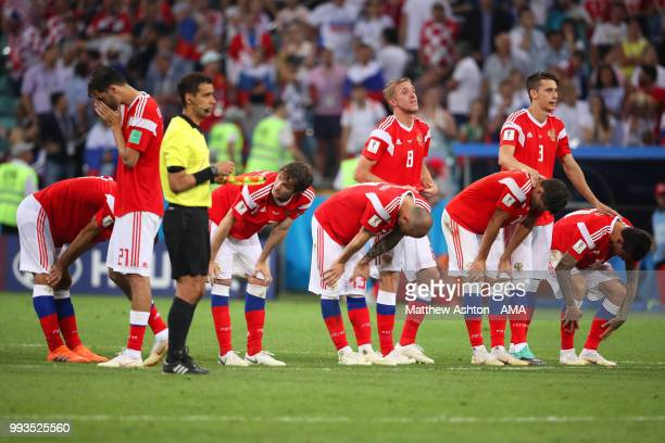 The Russia players react after losing in a penalty shootout during the 2018 FIFA World Cup Russia Quarter Final match between Russia and Croatia at...