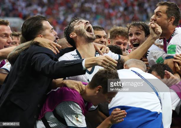 The Russia team celebrate with Aleksandr Erokhin of Russia during the 2018 FIFA World Cup Russia Round of 16 match between Spain and Russia at...