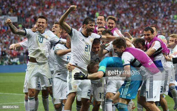 The Russia team celebrate with goalkeeper Igor Akinfeev of Russia during the 2018 FIFA World Cup Russia Round of 16 match between Spain and Russia at...