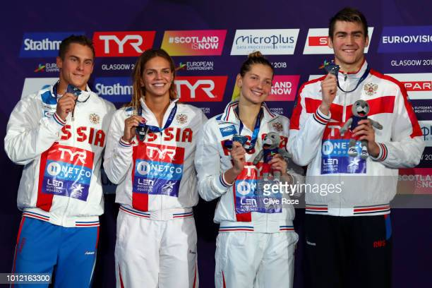 The Russia team pose with their silver medals after finishing second in the 4 x 100m Medley Relay Mixed Final during the swimming on Day five of the...