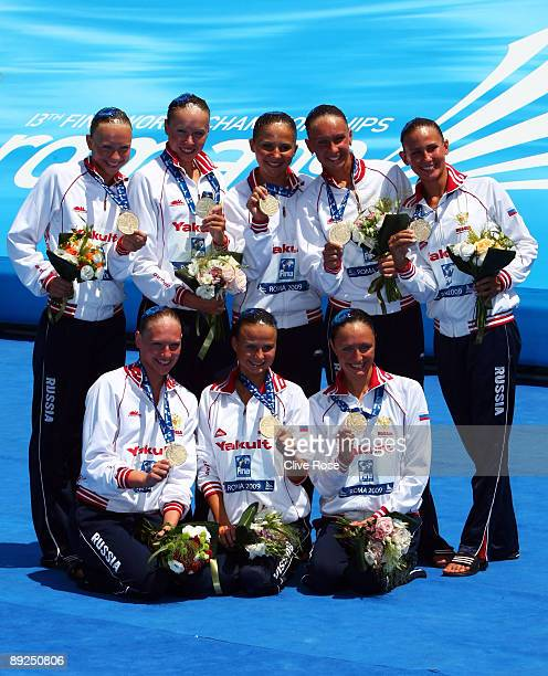 The Russia team receive their Gold medals for the women's Synchronised Swimming Team Free Finals during the 13th FINA World Championships at the...