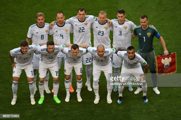 The Russia team Russia's midfielder Yuri Gazinskiy Russia's defender Sergey Ignashevich Russia's forward Artem Dzyuba Russia's defender Igor...