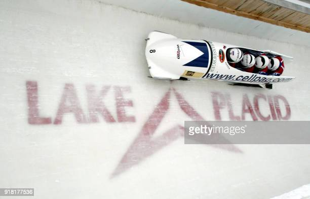 The Russia1 bobsleigh team driven by Alexandr Zoubkov goes through a turn during the first heat of the 2003 Verizon FIBT Men's Bobsleigh World...