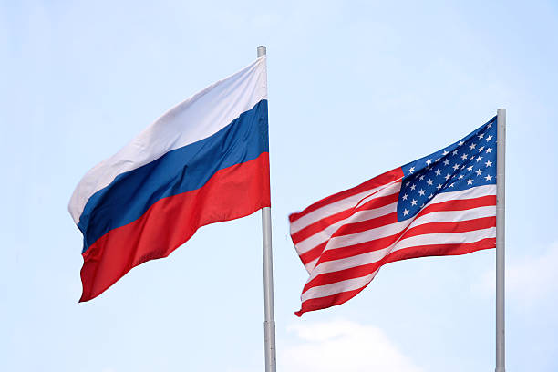 the russian and american flags flying side by side - 俄羅斯 個照片及圖片檔