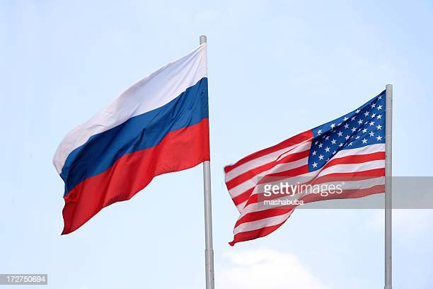 the russian and american flags flying side by side - verenigde staten stockfoto's en -beelden