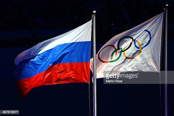 The Russian and Olympic flags fly during the Opening Ceremony of the Sochi 2014 Winter Olympics at Fisht Olympic Stadium on February 7 2014 in Sochi...