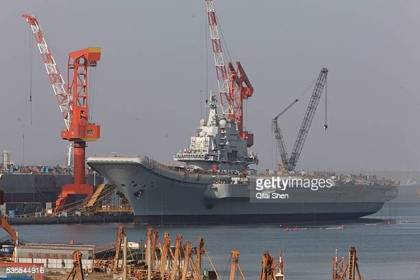 The Russian built aircraft carrier Varyag is seen docked in Dalian, Liaonin Province, China on 23 April 2011. Bought from Ukrain at an auction under...