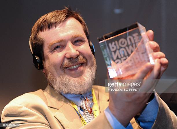 The Russian creator of the video game Tetris Alexey Pajitnov holds on April 9 2015 the Digital Greenhouse trophy during the inauguration of 17000...