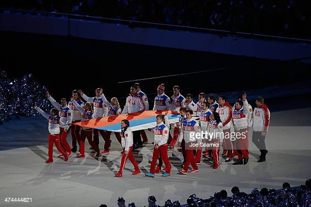 The Russian Flag is carried to the podium as part of the 2014 Sochi Winter Olympics Closing Ceremony at Fisht Olympic Stadium on February 23 2014 in...