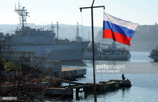 The Russian flag waves in front of the Ukrainian military ship the Slavutich moored in the bay of Sevastopol on March 22, 2014. About 200 pro-Russian...