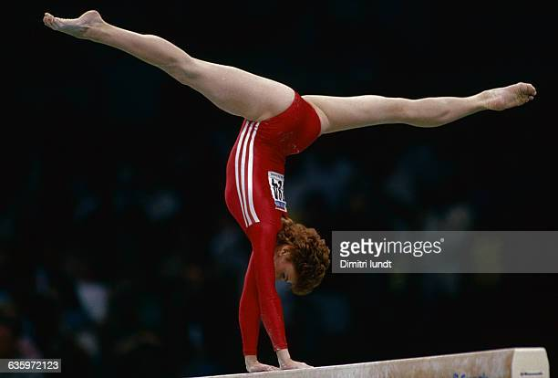 The Russian gymnast performs a routine on the beam during the Olympic Games