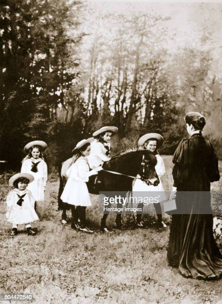 The Russian Imperial family, 1900s. Tsar Nicholas II's children at play with their pony, watched on by the Tsarina Alexandra . In age order: Grand...