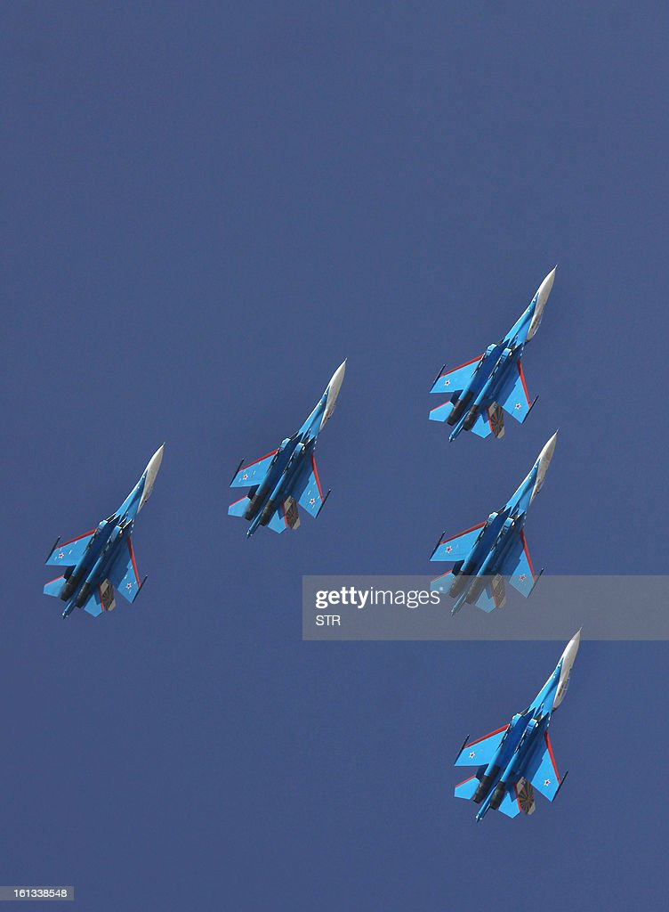 The Russian Knights aerobatic demonstration team of the Russian Air Force fly in arrow head formation in their Sukhoi SU-27s during an aerial display on the fifth and final day of Aero India 2013 at Yelahanka Air Force station in Bangalore on February 10, 2013. India, the world's leading importer of weaponry, opened one of Asia's biggest aviation trade shows February 6 with Western suppliers eyeing lucrative deals and a Chinese delegation attending for the first time.