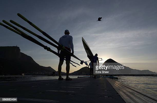 The Russian men's four bring their boat to the water to warm up prior to the rowing on Day 2 of the Rio 2016 Olympic Games at the Lagoa Stadium on...