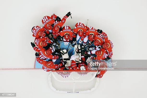 The Russian players huddle before their Ice Sledge Hockey Preliminary Round Group A match against Korea at Shayba Arena on March 8 2014 in Sochi...