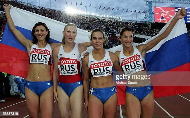 The Russian relay team Yuliya Pechonkina Olesya Krasnomovets Natalya Sologub and Svetlana Pospelova celebrate after the women's 4x400 metres relay...