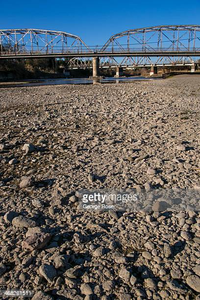 The Russian River is nearly dry as it flows under the Memorial Beach Bridge on January 25 in Healdsburg, California. With 2013 the driest year in...