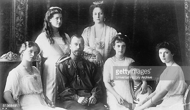 The Russian Royal family Seated the Grand Duchess Olga The Tsar the Grand Duchess Anastasia The Tsartitch Alexis the Grand Duchess Tatiana Standing...