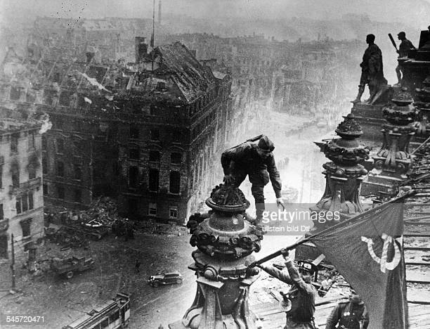 The Russian soldiers Jegorow and Kantarija hoisting the Soviet Flag on the destroyed Reichstag building May 1945 Picture taken by J Cheldej Also...