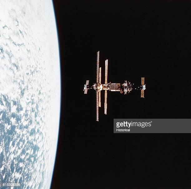 The Russian space station Mir in orbit above Earth before its encounter with the space shuttle Discovery February 6 1995
