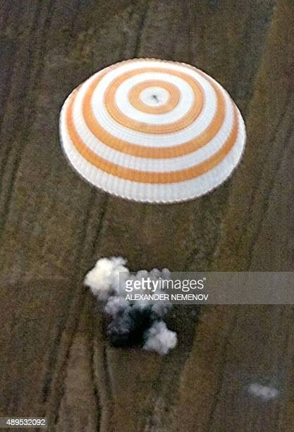 The Russian space vessel Soyuz lands early 28 August 1999 near the town of Arkalyk Kazakhstan with the last three members aboard the Russian space...