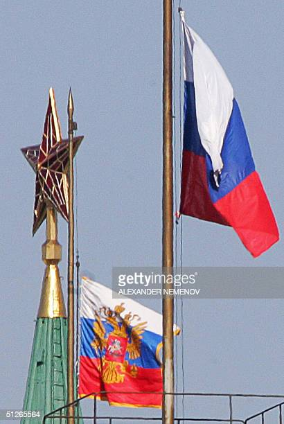 The Russian State Flag and the Standard of the President of Russian Federation flutter over Moscow's Kremlin with a Soviet era red star on the top of...