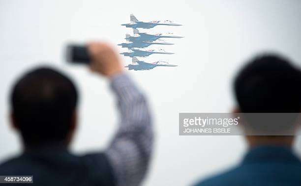 The Russian su 27 Knights team performs in their MB339A jets during a test flight ahead of the Airshow China 2014 in Zhuhai South China's Guangdong...