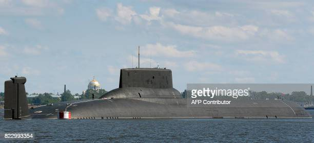 The Russian submarine Dmitry Donskoy the world's largest in active service arrives at Kronstadt Navy base outside Saint Petersburg on July 26 2017 to...