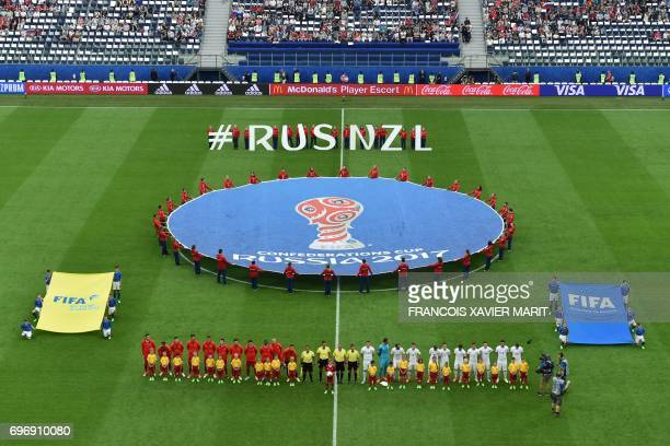 TOPSHOT The Russian team and New Zealand teams line up to listen to their national anthems at the start of the 2017 Confederations Cup group A...
