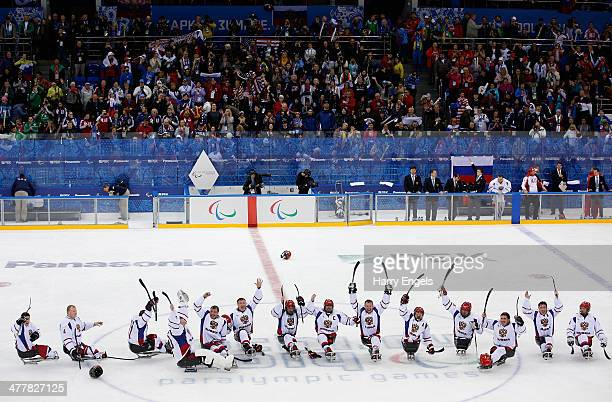 The Russian team celebrate victory during the Ice Sledge Hockey Preliminary Round Group B match between USA and Russia at the Shayba Arena during day...