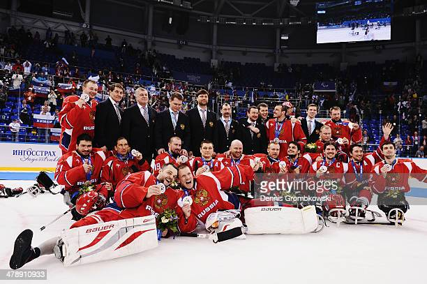 The Russian team celebrate winning the silver medal after the Ice Sledge Hockey Gold Medal game between the United States and Russia on day eight of...