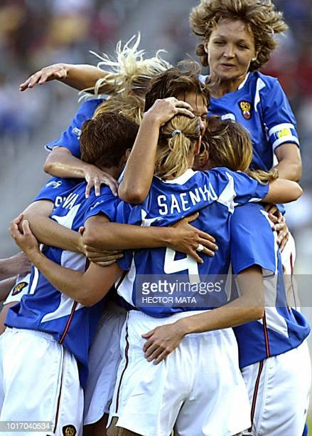 The Russian team congratulates Marina Saenko after scoring a goal against Ghana during the first half of their Group D match in the 2003 FIFA World...