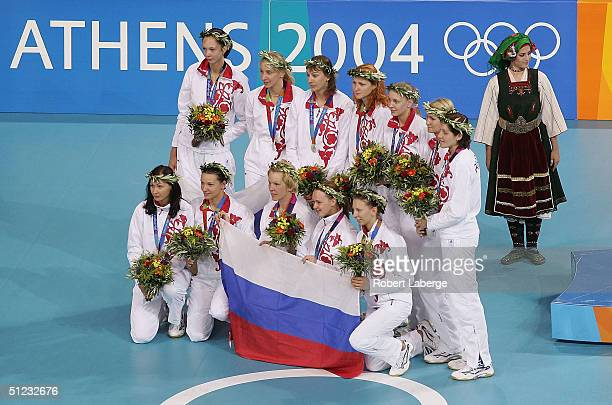 The Russian team pose for photographers after winning the silver medal in the women's indoor volleyball during ceremonies on August 28 2004 during...