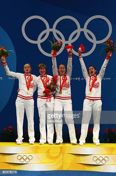 The Russian team with Svetlana Boyko Evgenia Lamonova Victoria Nikichina and Aida Shanaeva pose with the gold medal after the Fencing Women's Team...