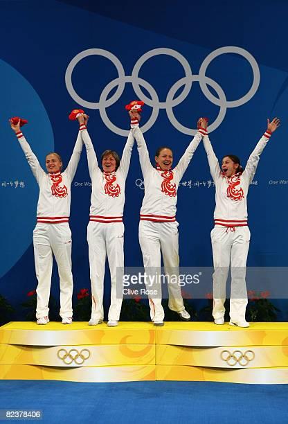 The Russian team with Svetlana Boyko Evgenia Lamonova Victoria Nikichina and Aida Shanaeva celebrate the gold medal after the Fencing Women's Team...