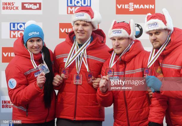 The Russian team with Tatjana Ivanova Roman Repilov Vladislav Antonov and Alexander Denisjev hold up their trophies after making the 3rd place at the...